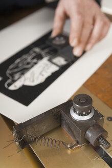 Germany, Bavaria, Man working in print shop - TC003338