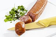 Smoked sausage on chopping board, close up - CSF017536