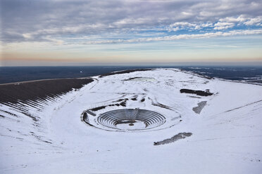 Germany, North Rhine Westphalia, Bottrop, View of Haniel Stockpile with amphitheater in winter - AKU000052