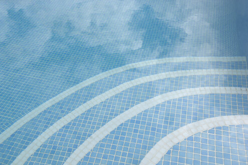 Germany, Reflection of tiles in swimming pool - AS004862