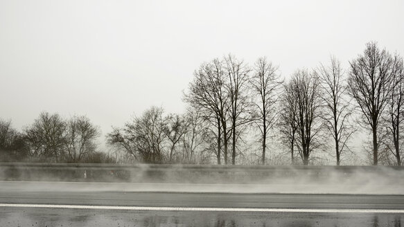 Germany, Jackerath, View of motorway in rain - HL000086