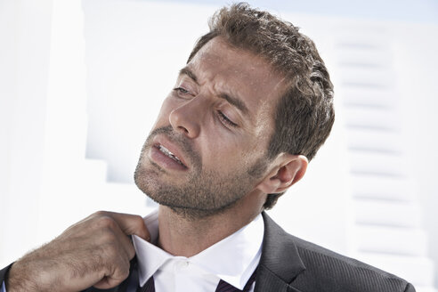 Tired businessman in black suit, close up - PDYF000430