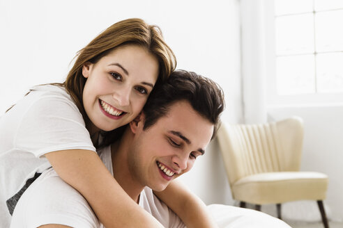 Young couple embracing each other, smiling - SPOF000083