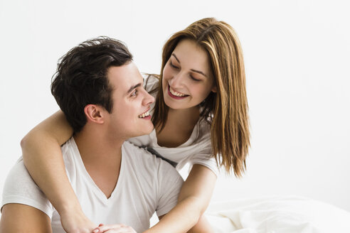 Young couple embracing each other, smiling - SPOF000108