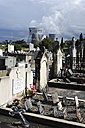 France, Rhone, Cemetery with smoking cooling towers of power plant in background - CR002321