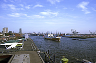 Germany, Hamburg, View of harbour with container ship in Elbe river - ALE000013