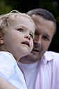Germany, Girl with her father, looking away - JFE000060
