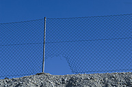 Germany, Bavaria, Wire mesh fence with hole - CRF002331