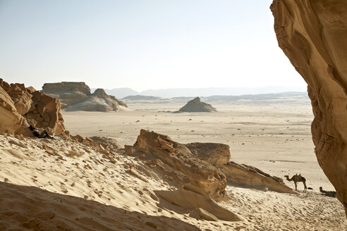 Egypt, Mid adult woman sitting alone in desert - TK000110