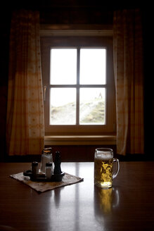 Austria, Beer mug with beer on table - TK000083