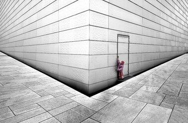 Norway, Oslo, Girl trying to open door of opera house - CWF000015