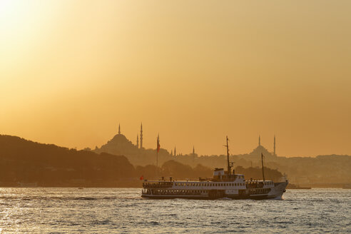 Turkey, Istanbul, View of ferry boat in Bosphorus, Suleymaniye Mosque and fatih Mosque in background - SIE003489