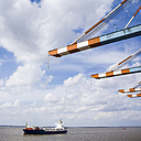 Germany, Bremerhaven, Container ship passing pier - DIS000062
