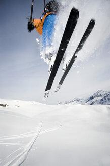 Austria, Man jumping with ski on mountain - RN001155