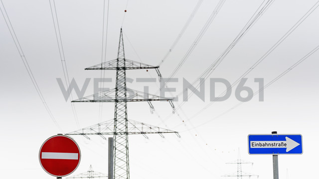 Germany, North Rhine Westphalia, Road signs for one way and power poles - HLF000106