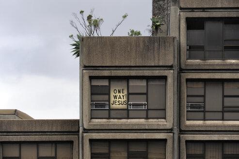 Australia, New South Wales, Sydney, Text on window of concrete apartment - MIZ000290
