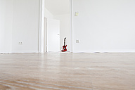 Guitar leaning on wall - FMKF000525