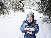 Austria, Boy playing with snow in forest - CW000018