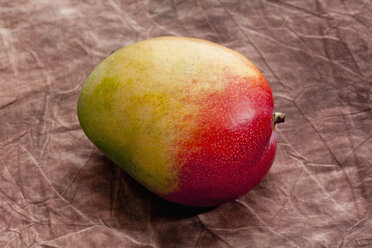 Mango on brown background, close up - CSF018044