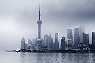 China, Shanghai, Financial District with dramatic sky - FL000316
