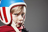Portrait of boy with racer helmet, close up - ED000001