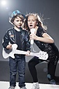 Girl and boy playing band on stage with paper guitar and microphone - ED000007