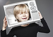 Boy crying in paper TV against grey background - ED000016