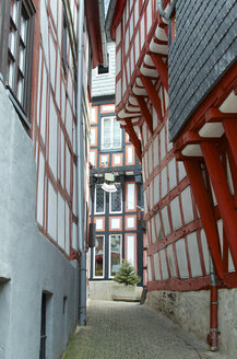 Germany, Hessen, Limburg, Timbered frame building with alley - MH000141