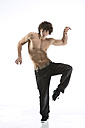 Mid adult man practising dance moves - MAEF006243