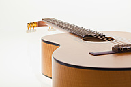 Acoustic guitar on white background, close up - WDF001637