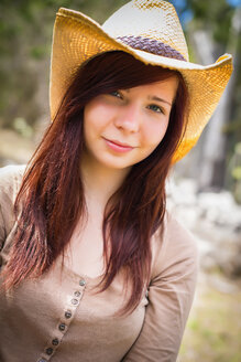 USA, Texas, Portrait of young woman with cowboy hat, smiling - ABA000784