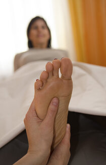 Austria, Woman getting foot massage - CW000021