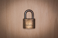 Closed security lock on wooden background, close up - KJF000210