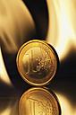 One euro coin burning - MU001268