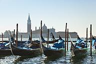 Italy, Venice, Gondolas docking at St Mark's Square - HSIF000227
