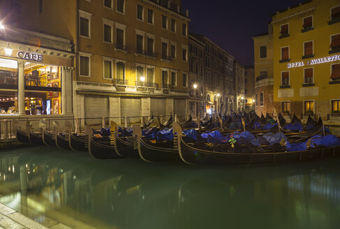 Italy, Venice, Gondalas on canal near St Mark's Square at night - HSIF000263