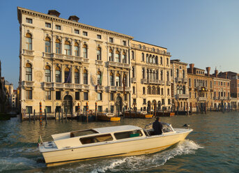 Italy, Venice, Man in water taxi on Canal Grande - HSI000267