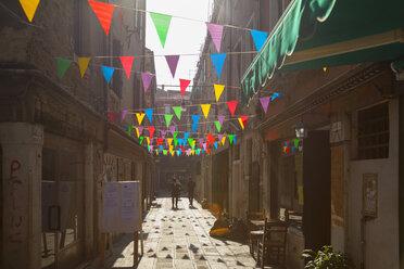 Italy, Venice, Colourful flags in Cannaregio - HSI000200