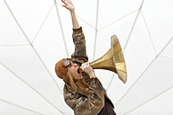 Germany, Paderborn, Woman shouting into Gramophone funnel - AJF000003