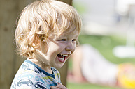 Austria, Boy laughing and looking away, close up - LF000515