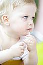 Baby girl eating spaghetti, close up - LFF000524