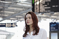 Germany, Cologne, Young woman at airport - RHYF000301