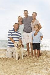 Spain, Portrait of family on beach at Palma de Mallorca, smiling - SKF001235