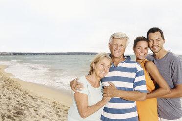 Spain, Family on beach at Palma de Mallorca, smiling - SKF001211