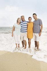 Spain, Portrait of family on beach at Palma de Mallorca, smiling - SKF001176