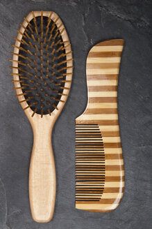 Hair brush and comb on slate board, close up - TDF000043