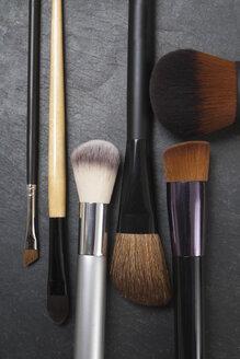 Make up brushes on slate board, close up - TDF000007