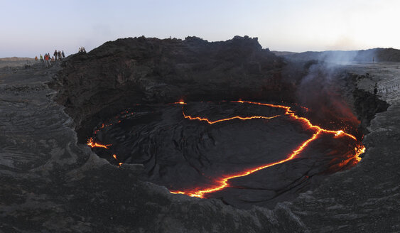 Ethiopia, View of lava at Erta Ale while people in background - MR001317