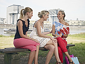 Germany, Cologne, Young women laughing near harbour - RHYF000360