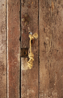 Spain, Door of old town with key, close up - WWF002823